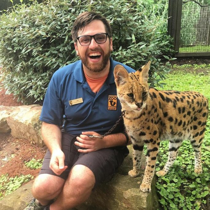 clouded leopard and animal keeper at Nashville zoo