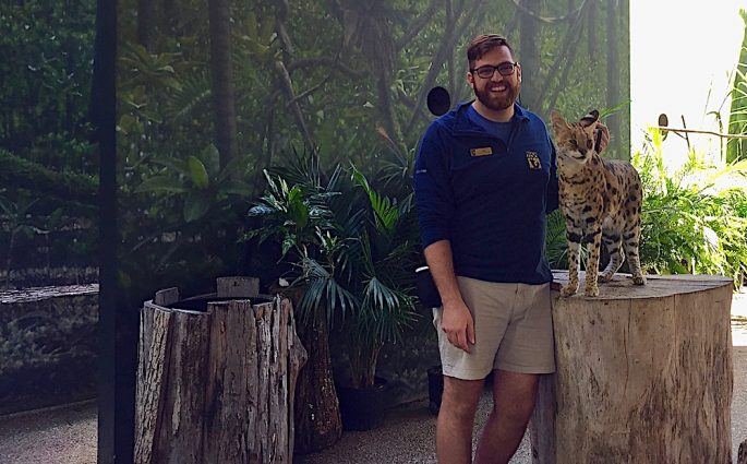 animal keeper and clouded leopard at Nashville zoo