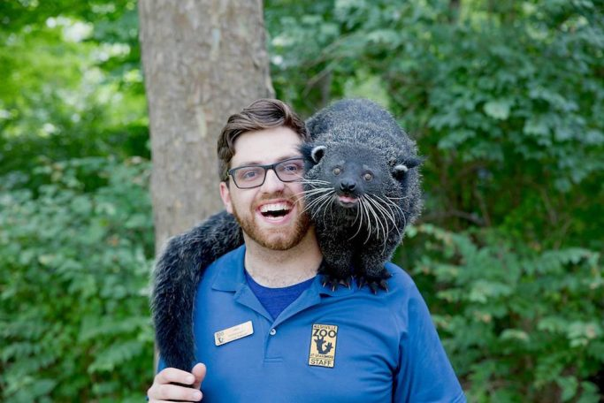 animal keeper and binturong at Nashville zoo
